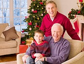 Multi_generation family near Christmas tree