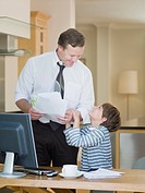 Businessman and son in home office