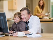 Businessman and son using computer