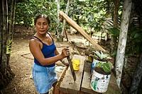 Woman Holding Large knife, Castanha Community, Negro River, Novo Airão, Amazonas, Brazil