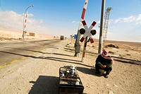 Coffee seller by railway crossing on the road to Palmyra, Syria