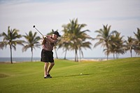 Golfer playing in Estella Del Mar Golf Country Club, Robert Trent Jone Jr. championship course design, Mazatlan, Sinaloa, Mexico