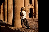 Man standing by royal tomb in Petra