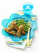 Breaded strips of fish with peas