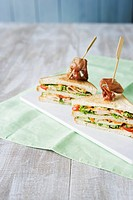 Double_decker sandwich with prosciutto skewers