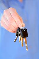 Hands holding car keys