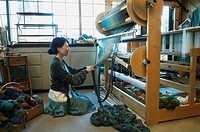 Weaver working in studio