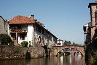 The medieval bridge across the River Nive in St Jean Pied a Port in south west France