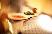 Waiter Serving Tuna and Arugula Salad