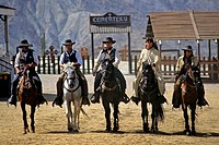 Spain, Andalusia, Almeria Province, Tabernas Desert, the arrival of the bad guys with the actors of the Mini Hollywood West village prepared to rob a ...