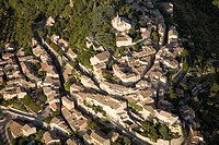 France, Vaucluse, Parc naturel regional du Luberon, village of Bonnieux aerial view