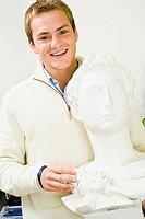Man holding a bust