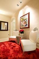 Home interior, corridor,with red carpet and white armchairs
