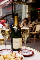 France, Marne, Reims, Cafe du Palais terrace, champagne cocktail