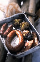 France, Haute Savoie, La Chapelle_d´Abondance, cooking of sausage and cabbage, cooked diots and grilled lard from butcher Mollaz during trapper day, B...