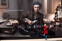 United Kingdom, London, Mayfair, pedestrian in front of a publicity for Louis Vuitton with Keith Richards guitarist of the Rolling Stones
