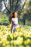 Girl running through flowers