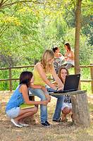 group of students with a PC in the park