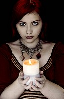 A girl holding a candle