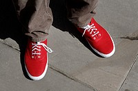 New red plimsole shoes