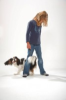 Girl with Cavalier King Charles Spaniel, tricolour, trick eight
