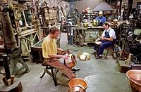 France, Manche, Villedieu les Poeles, Atelier du Cuivre Copper workshop and Maison de l´Etain tin house, hammering Model and property release OK