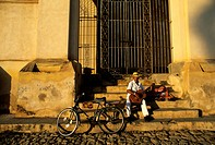 Cuba, Sancti Spiritus Province, Trinidad de Cuba listed as World Heritage by UNESCO, street musician on the steps of the Santisima Trinidad Cathedral