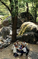 North Korea, Myohyang, group of men resting