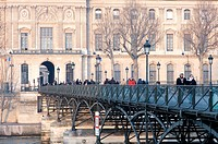 France, Paris, banks of the Seine River listed as World Heritage by UNESCO, Pont des Arts and the Louvre in the background