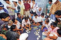 Indonesia, Bali, Munduk, card players with money betting