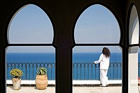 Morocco, Tangier Tetouan Region, Tangier, Kasbah, Nord_Pinus Tanger Hotel, lady client on hotel terrace looking at the Strait of Gibraltar