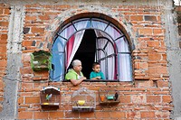 Mexico, Guerrero state, Taxco, the old city, grandmother and her grand_son at the window