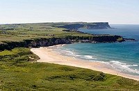 White Park Bay with the small fishing village of Portbradden at the western end of the beach, part of the north Antrim coast