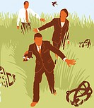 Businesspeople avoiding traps in grass