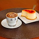 Close_up of a cup of coffee with a mousse cake