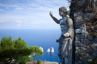 I Faraglioni rocks and Statue on Monte Solaro, Capri, Italy