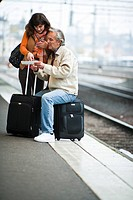 A couple waiting for a train Sweden.