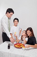 Family eating nachos with salsa