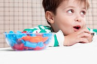 Close_up of a boy eating a candy