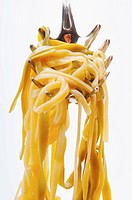 Close_up of cooked spaghetti on a ladle