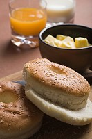 Close_up of bread with butter and glasses of juice