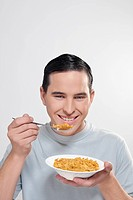 Man eating corn flakes