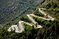 Hairpin bends in the road through hills in southern France