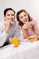 Man with his daughter at a breakfast table