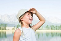 Girl 6_12 blond, looking into the distance, wearing hat, outdoors