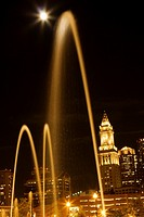 nighttime skyline of Boston with fountains and full moon closer