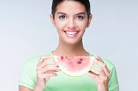Portrait of a woman holding a watermelon slice