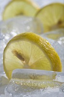 Lemon slices on ice cubes