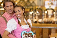 Young couple in traditional Bavarian costume at the Oktoberfest, Munich, Germany