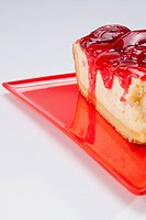 Close_up of a slice of strawberry cheesecake